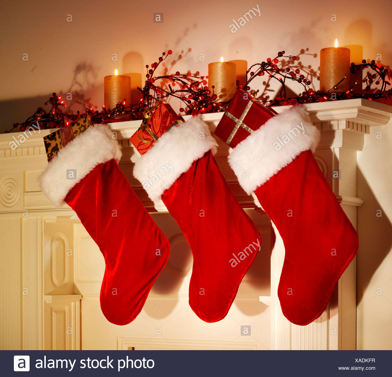 CHRISTMAS STOCKINGS HANGING ON FIREPLACE Stock Photo ...