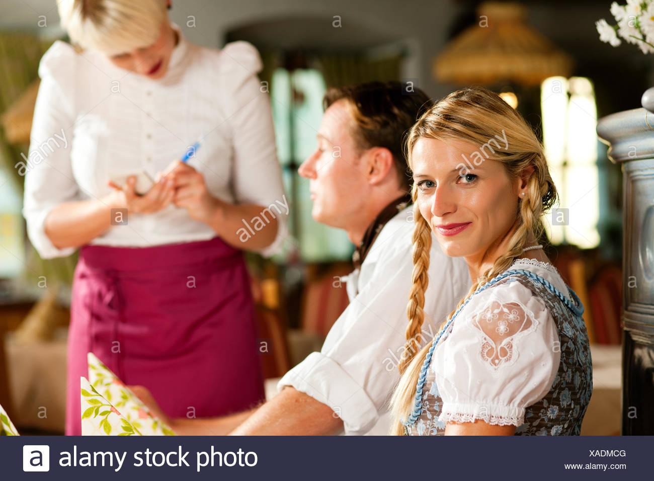 couple ordered in bavarian restaurant Stock Photo