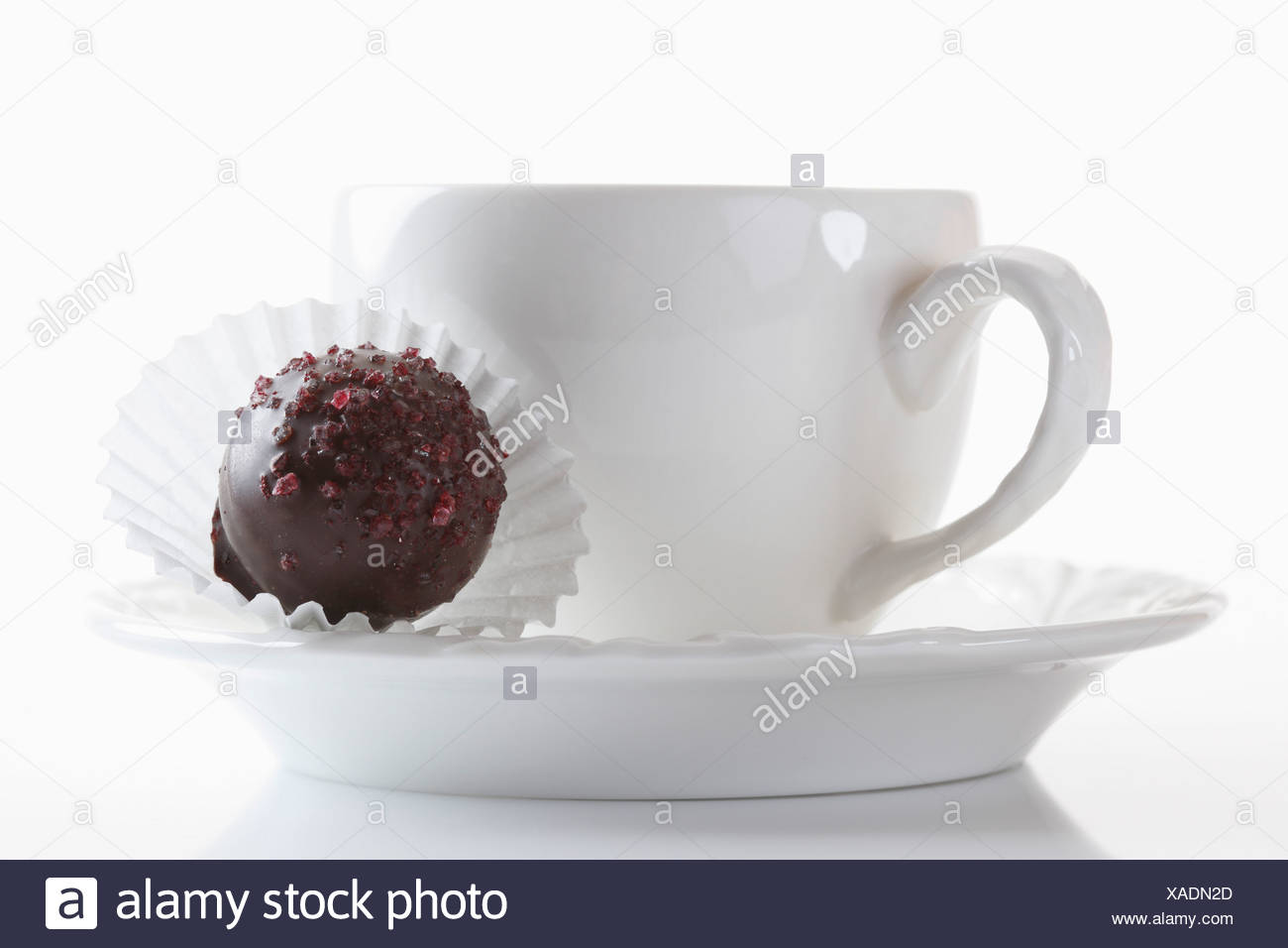 Coffee cup with chocolate on white background, close up Stock Photo