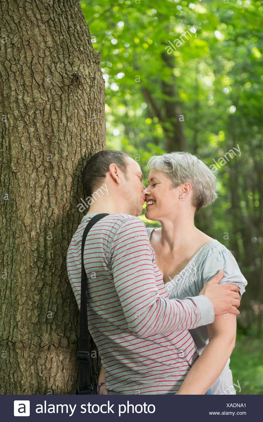 mature couple kissing in forest stock photo: 281814569 - alamy