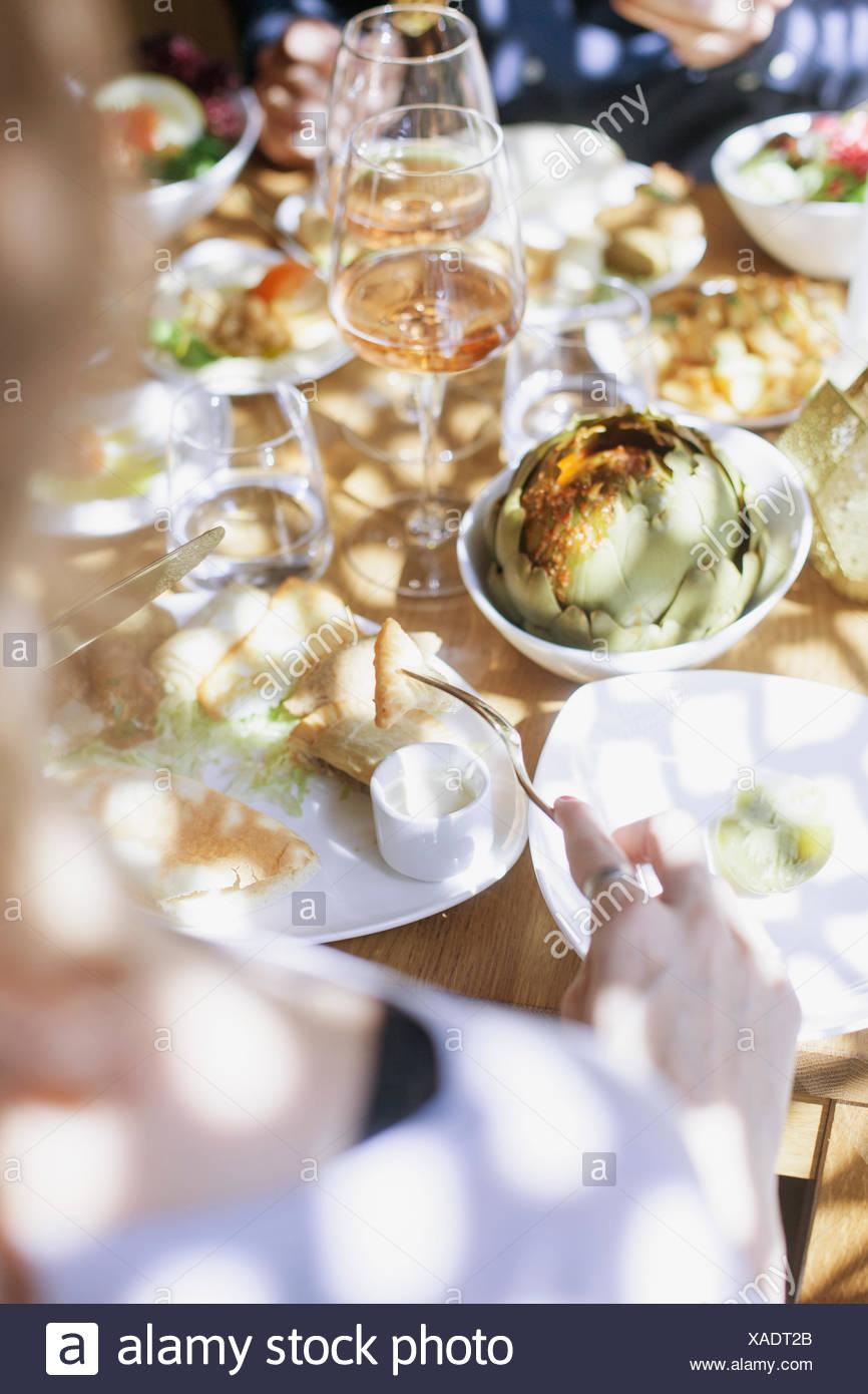 Cropped image of couple having meze at Lebanese restaurant - Stock Image