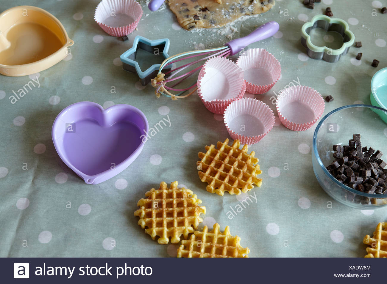 Baking implements in messy kitchen - Stock Image