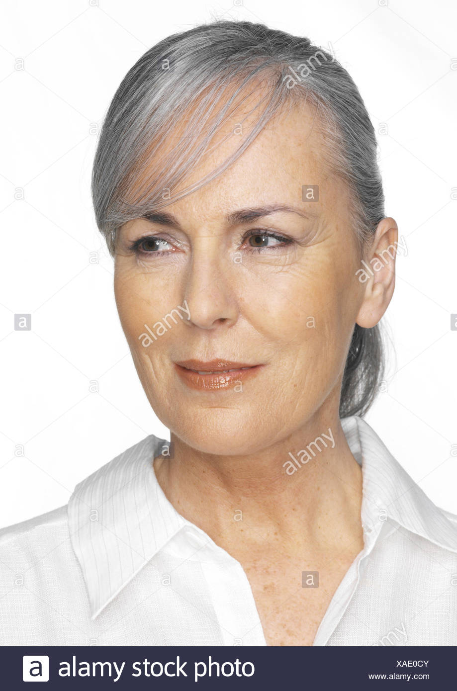 Senior, hairs tied together, view page, smile, portrait, woman, 55-65 years, middle old person, Best Age, blouse, grey-haired, hairstyle, made up, discreetly, naturalness, cultivated, dapperly, attractively, satisfaction, balance, beauty, Beauty, transmis - Stock Image