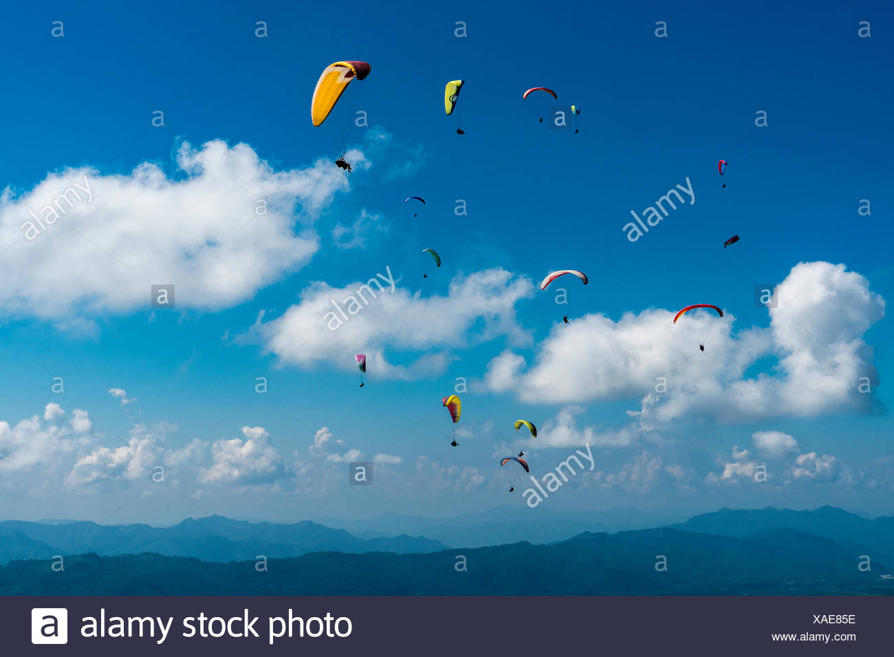 Many paragliders are flying over Pokhara and Phewa Lake, Sarangkot, Kaski District, Nepal - Stock Image