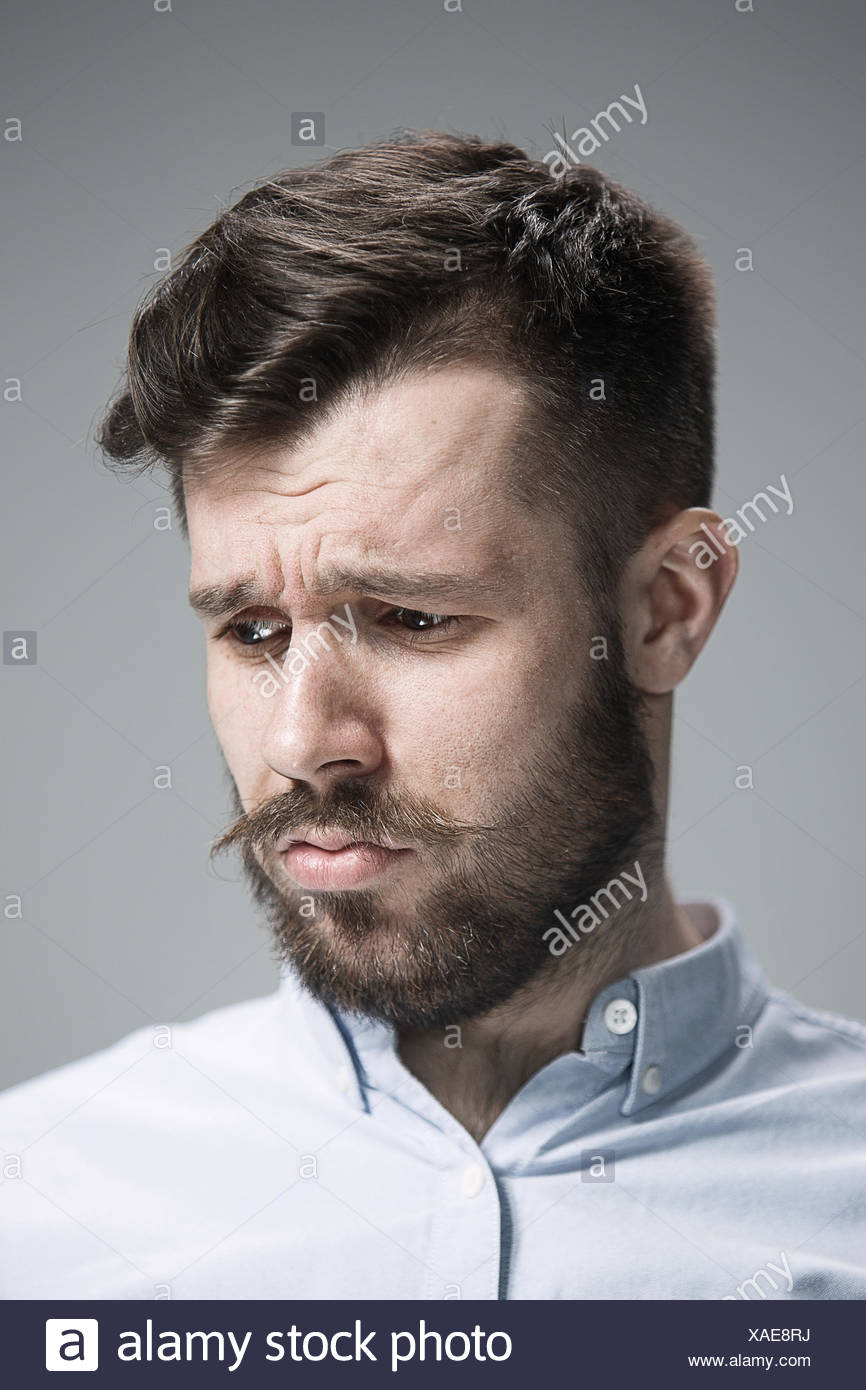 Close up face of  discouraged man - Stock Image