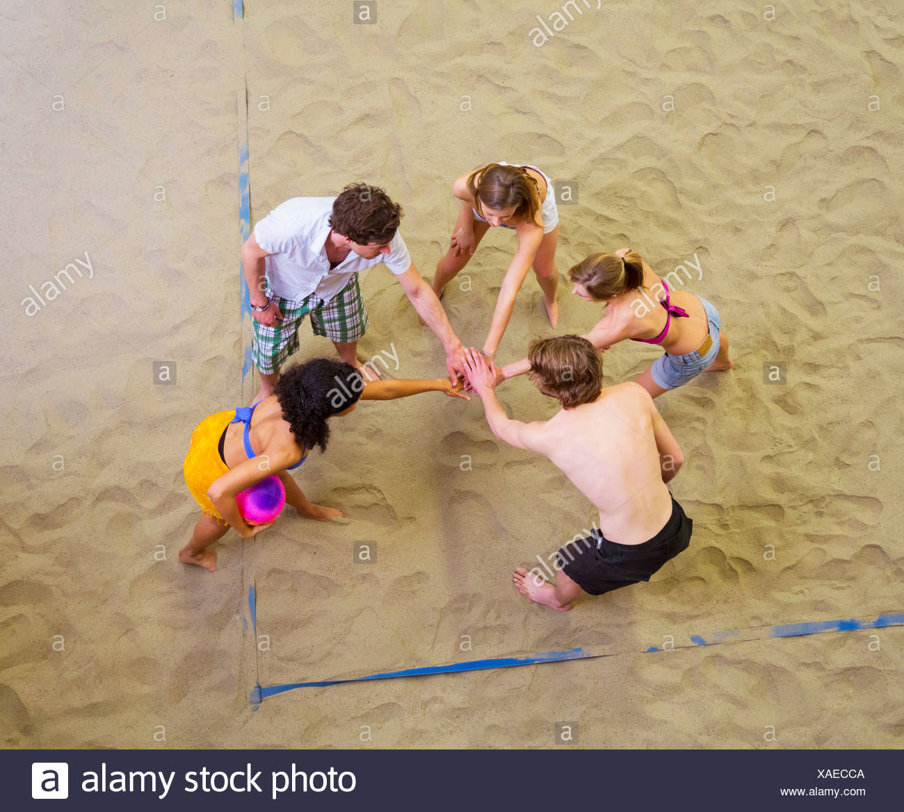 Aerial view of friends team talk at indoor beach volleyball - Stock Image