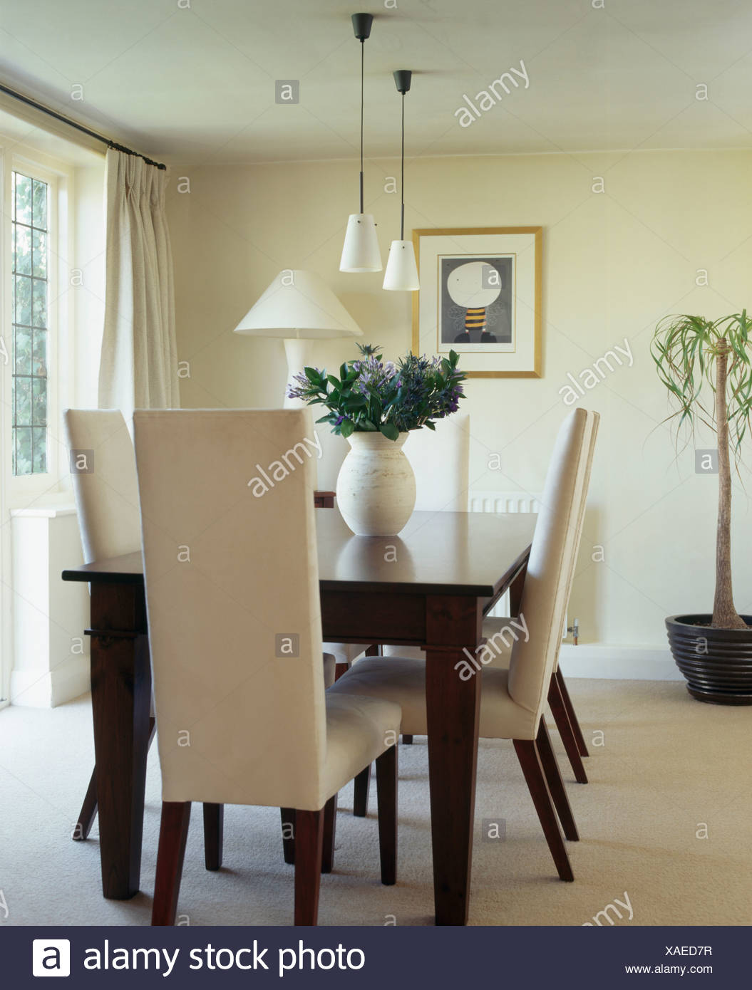 Cream Upholstered High Back Chairs And Dark Wood Table In Modern
