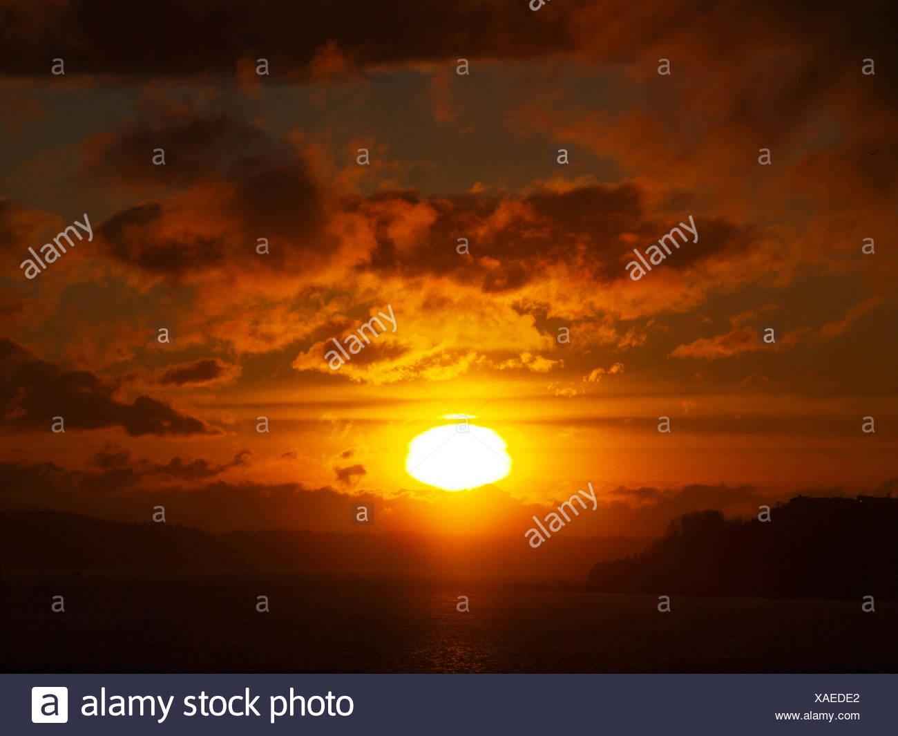 USA, Washington State, King County, Seattle, Sunset over land Stock Photo