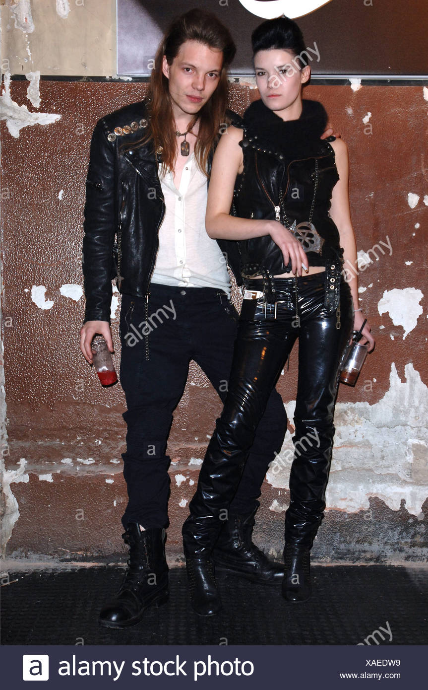 McQ by Alexander McQueen Menswear Milan A W Brunette female and blonde male long hair dressed to look like heroin chic rockers - Stock Image