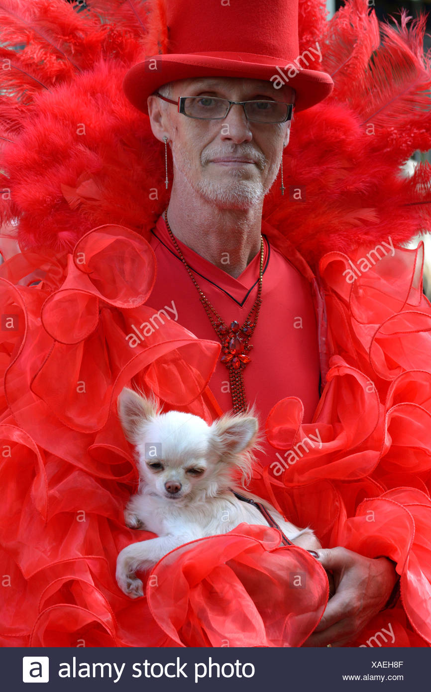 Mature man in scene clothes with dog, Wave-Gotik-Treffen, Leipzig, Saxony, Germany Stock Photo