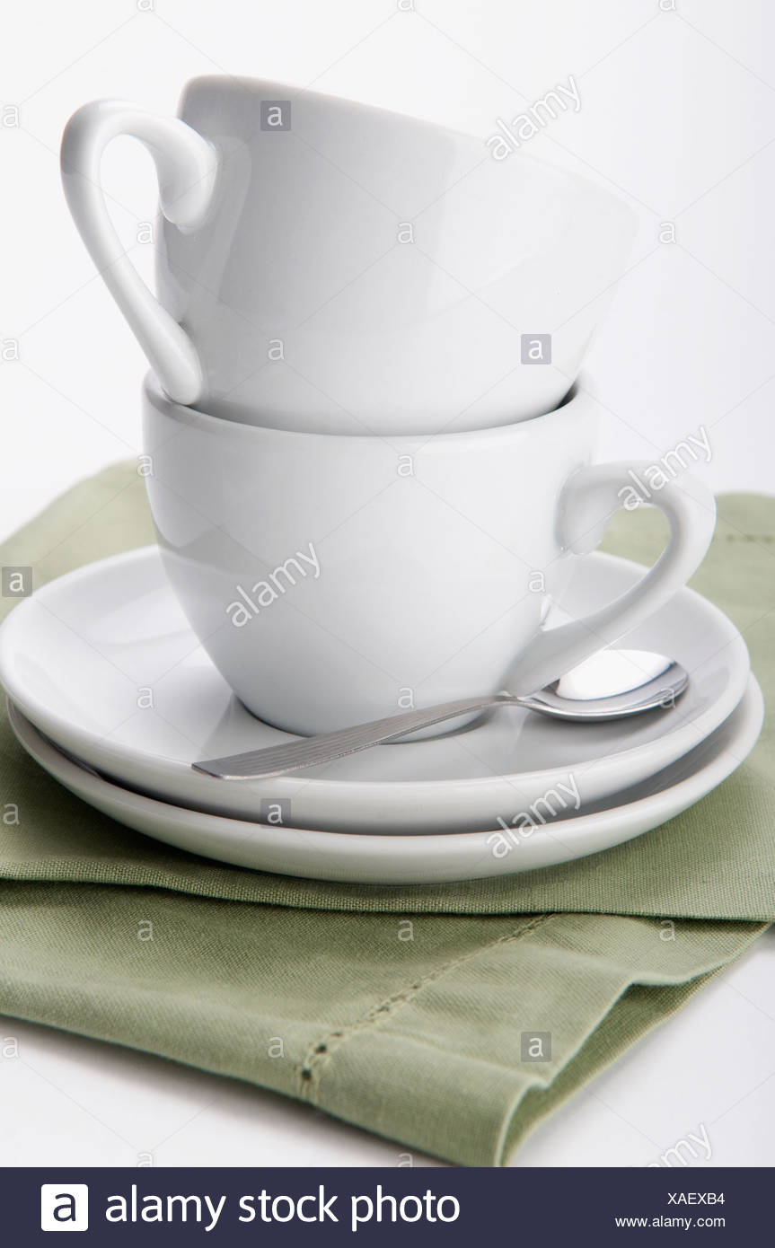 Close-up of teacups and saucers - Stock Image