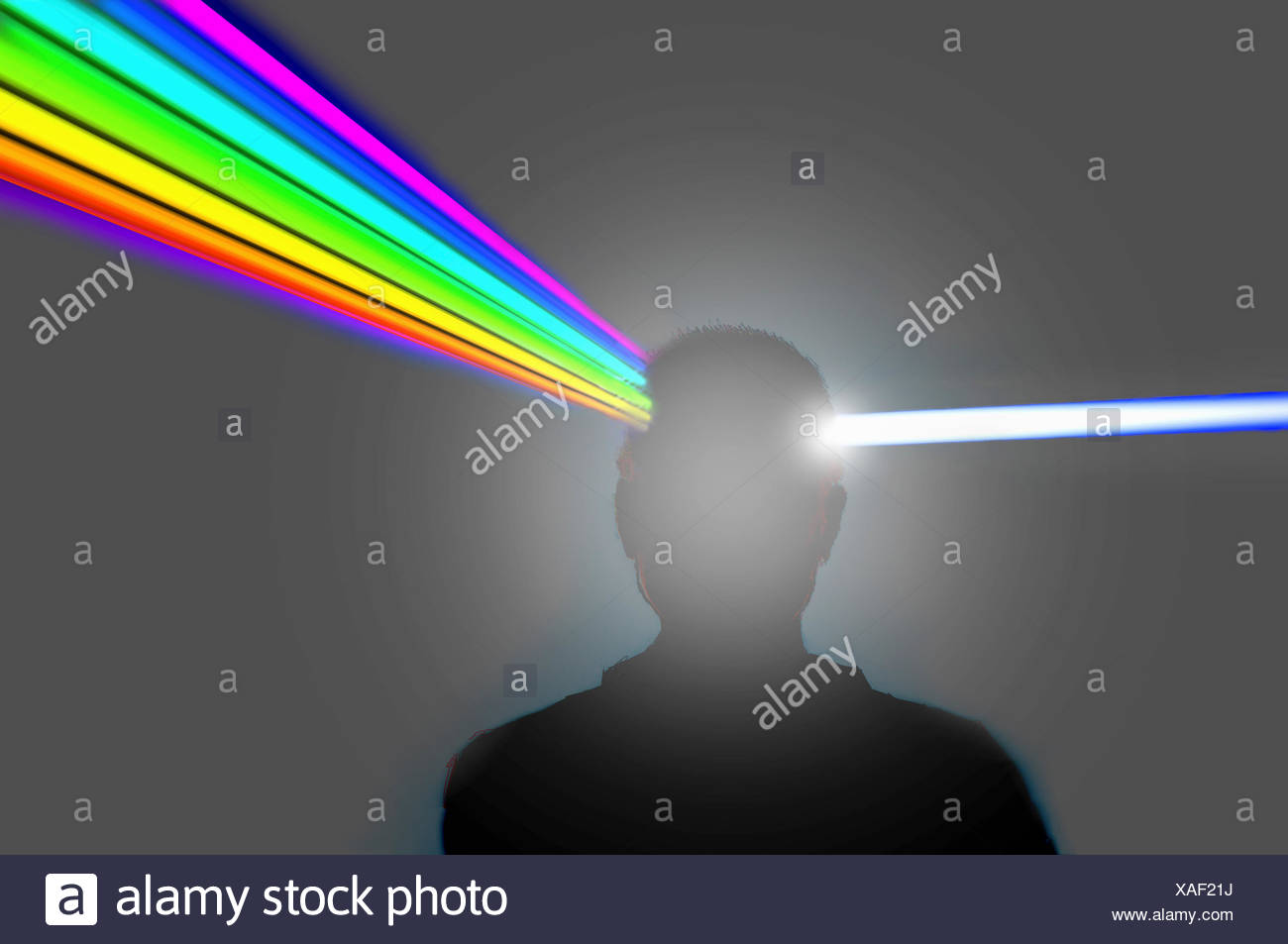 Man's head as prism refracting beam of light into color spectrum - Stock Image