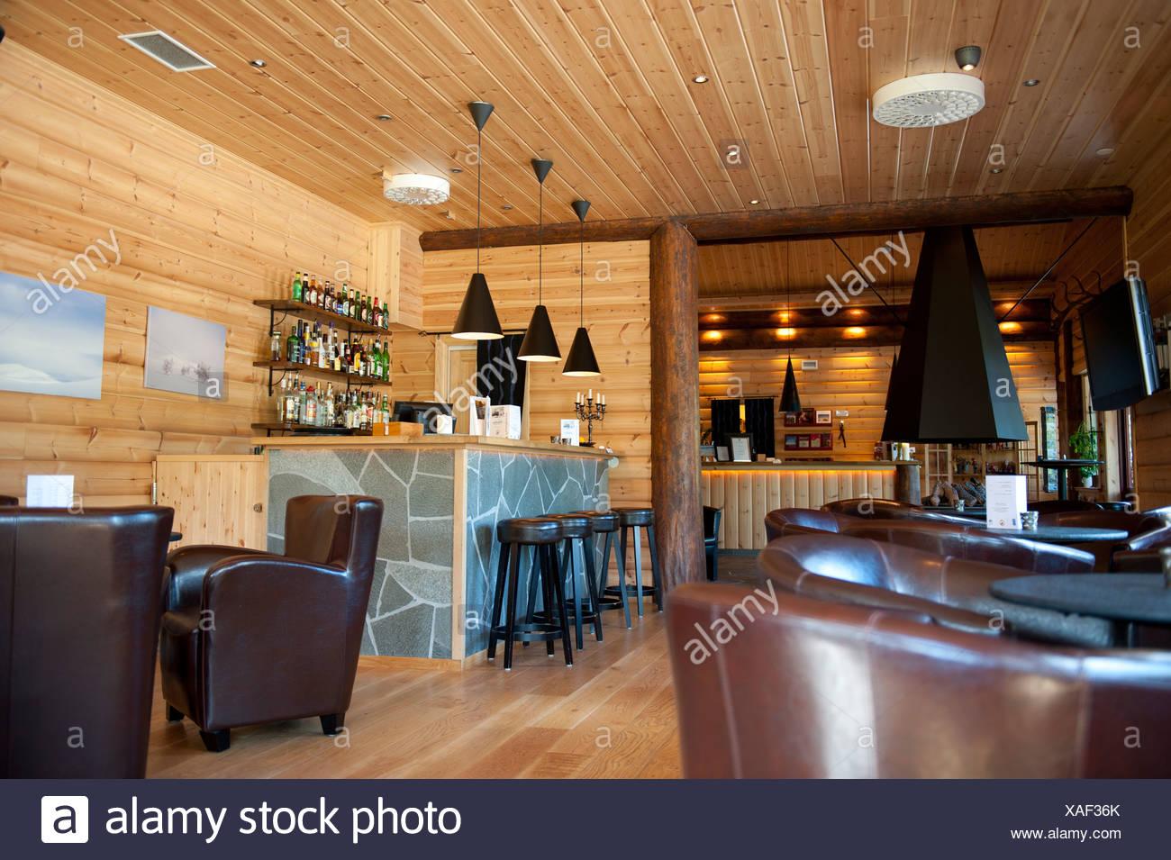 Reception and piano bar with leather armchairs, Storsaetra Fjaellhotell Hotel, near Groevelsjoen, Dalarna province, Sweden - Stock Image