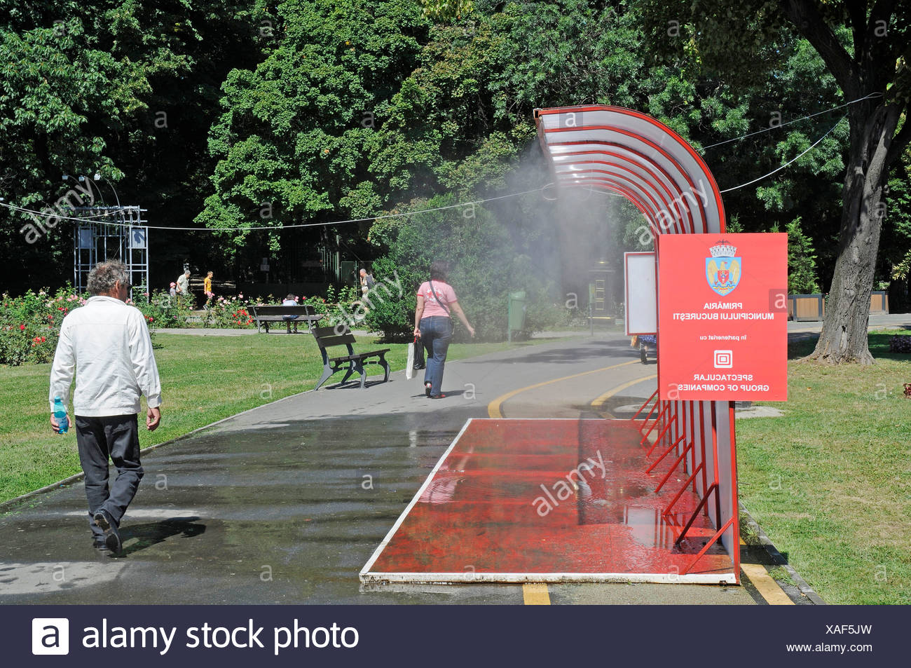 Public water sprinkling system, hot weather, water, cooling, summer, Bucharest, Romania, Eastern Europe, Europe, PublicGround Stock Photo