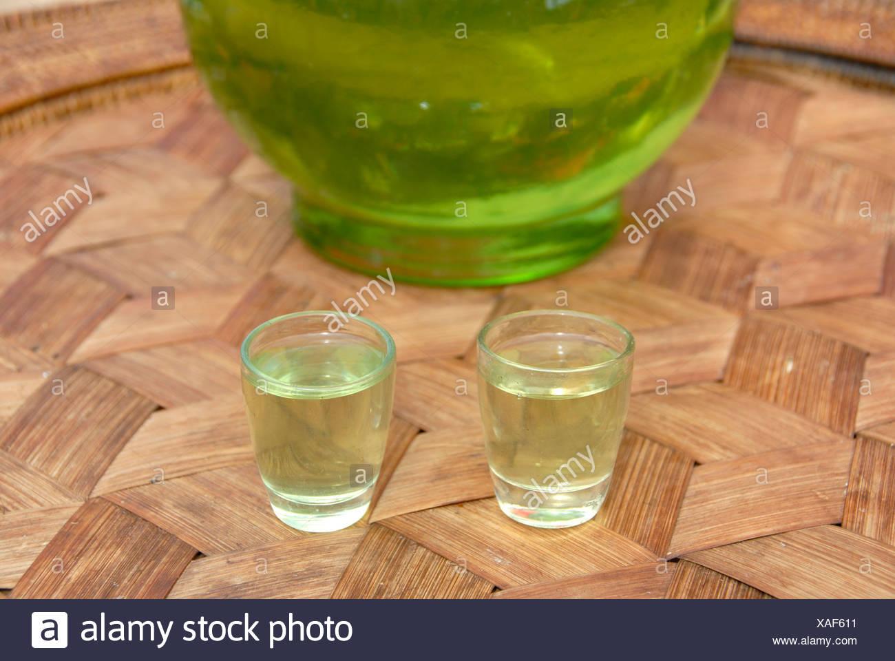 Alcohol, Green Lao Lao, Lao rice liquor in two shot glasses, Phongsali, Laos, Southeast Asia, Asia Stock Photo