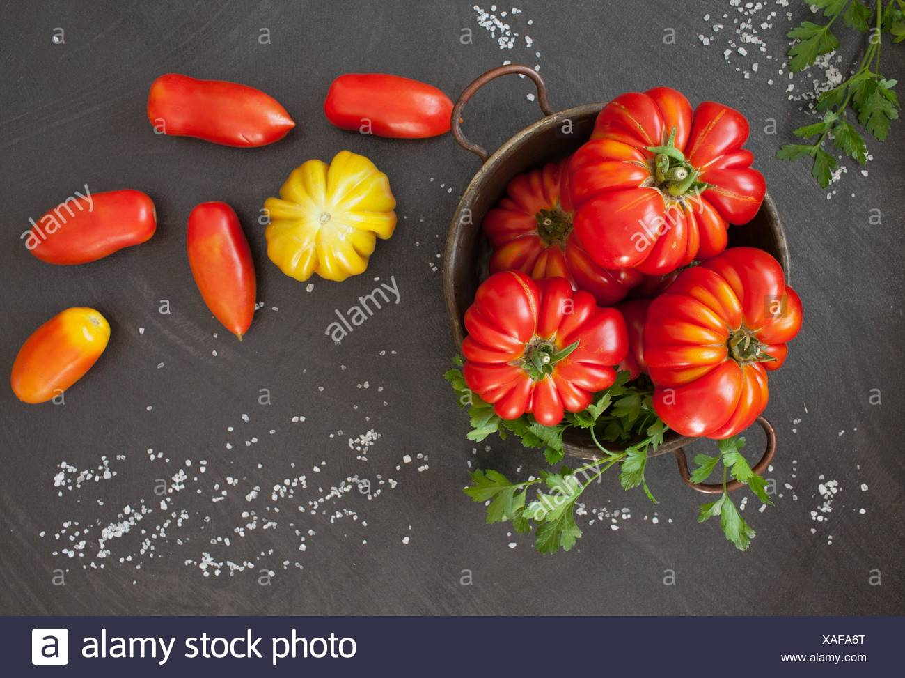 Fresh tomatoes: Heirloom and oblong type. - Stock Image