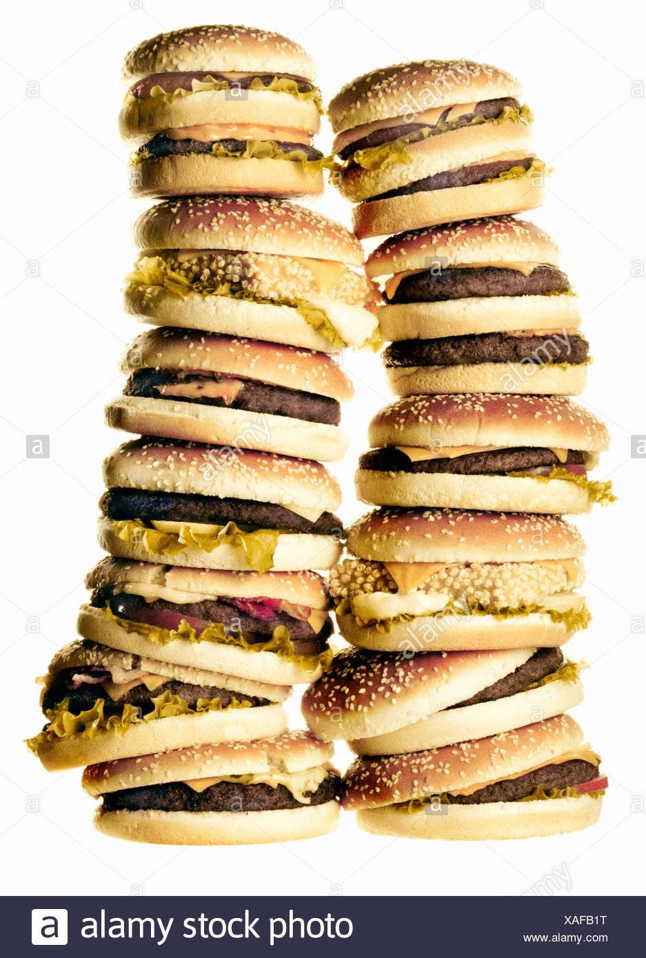 Stack of hamburgers, studio shot - Stock Image