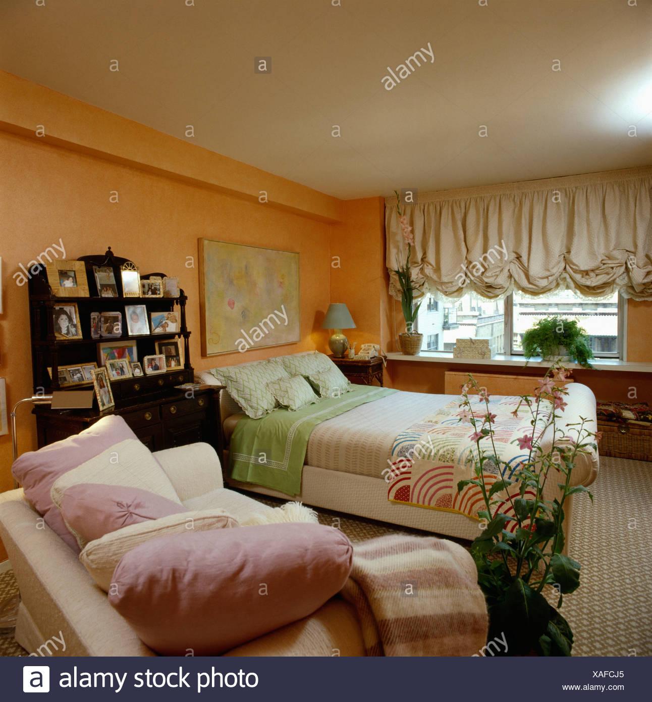 Cream festoon blind and orange walls in eighties bedroom ...