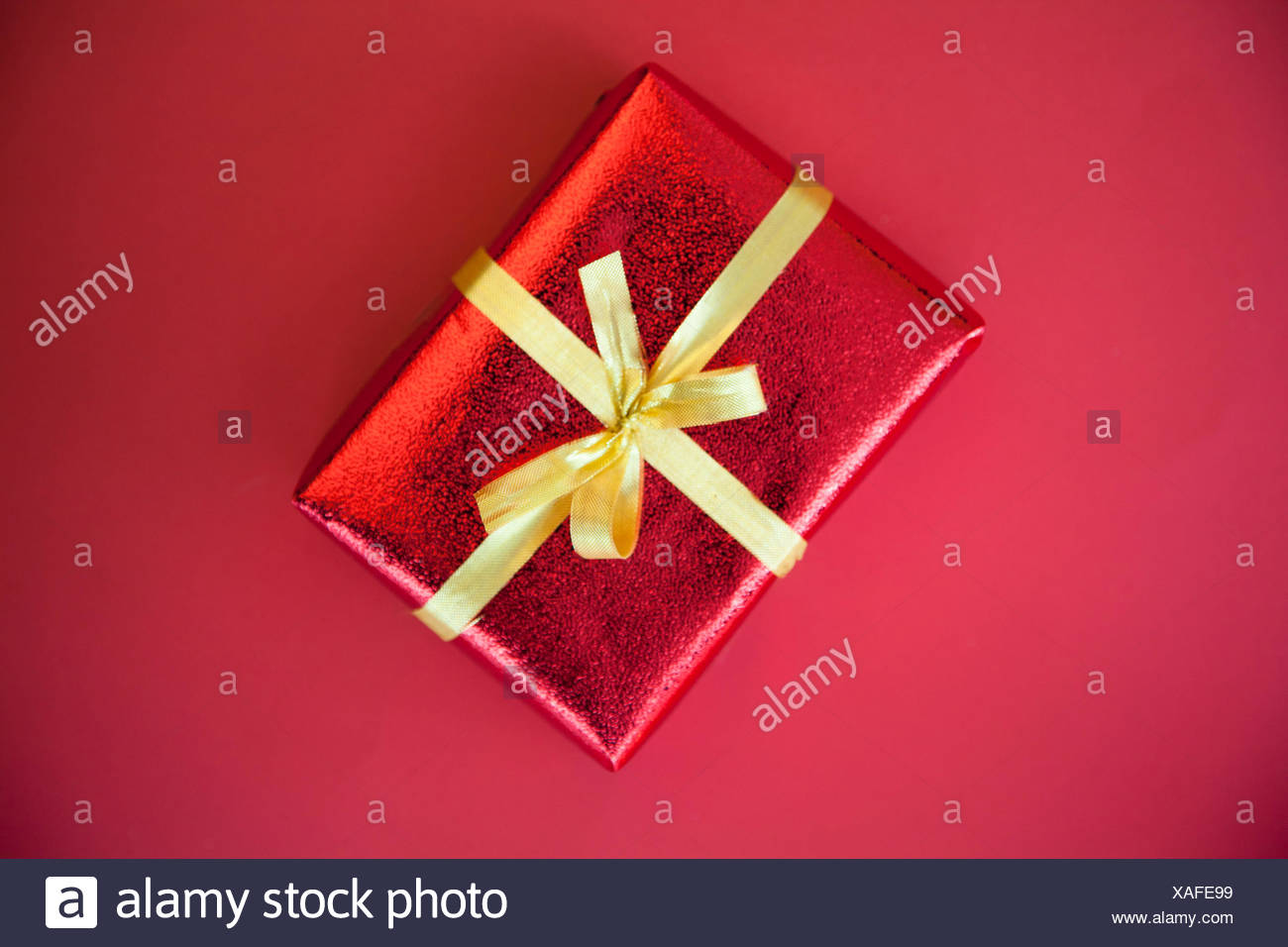 Gift wrapped with tied bow - Stock Image
