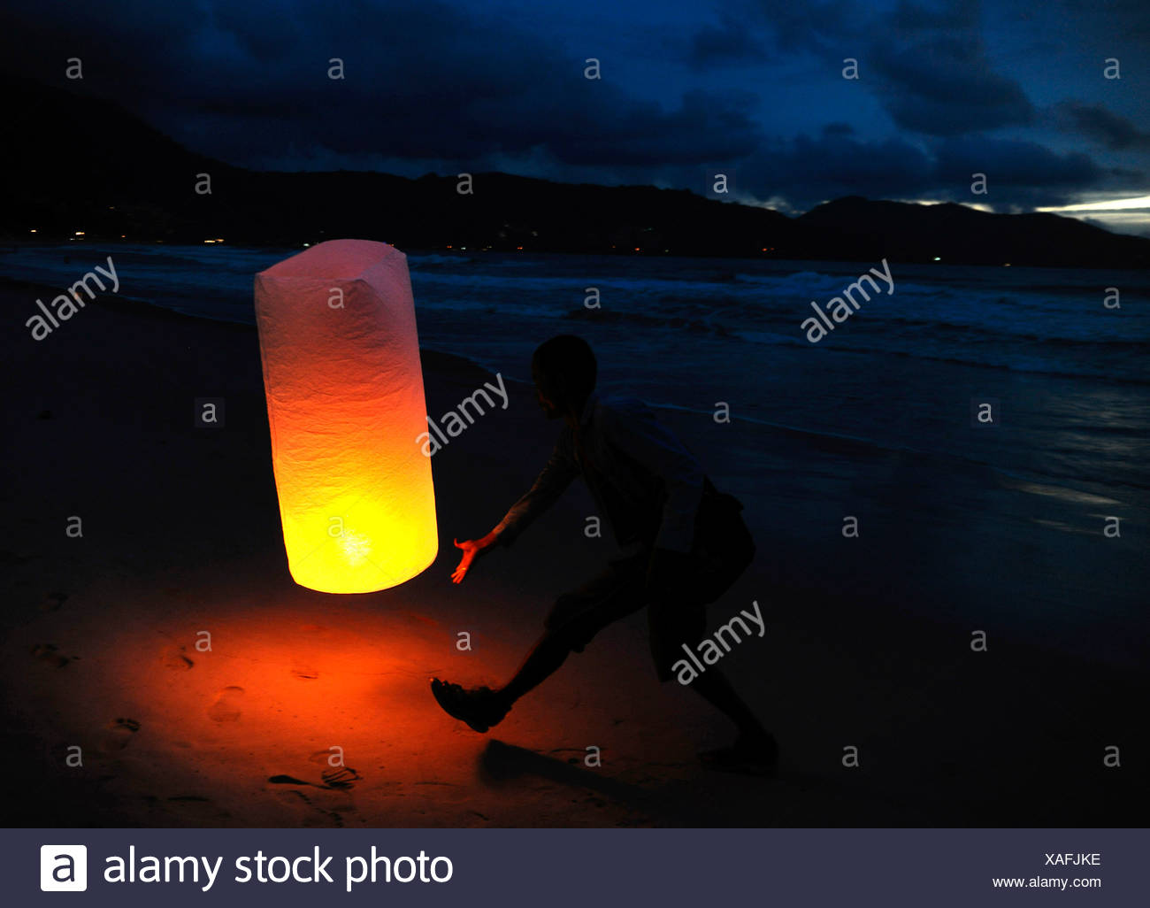 Man with a fortune balloon, Thailand, Asia - Stock Image