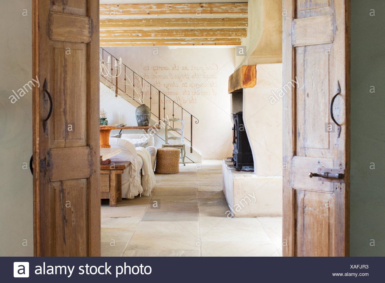 Living room in rustic house - Stock Image