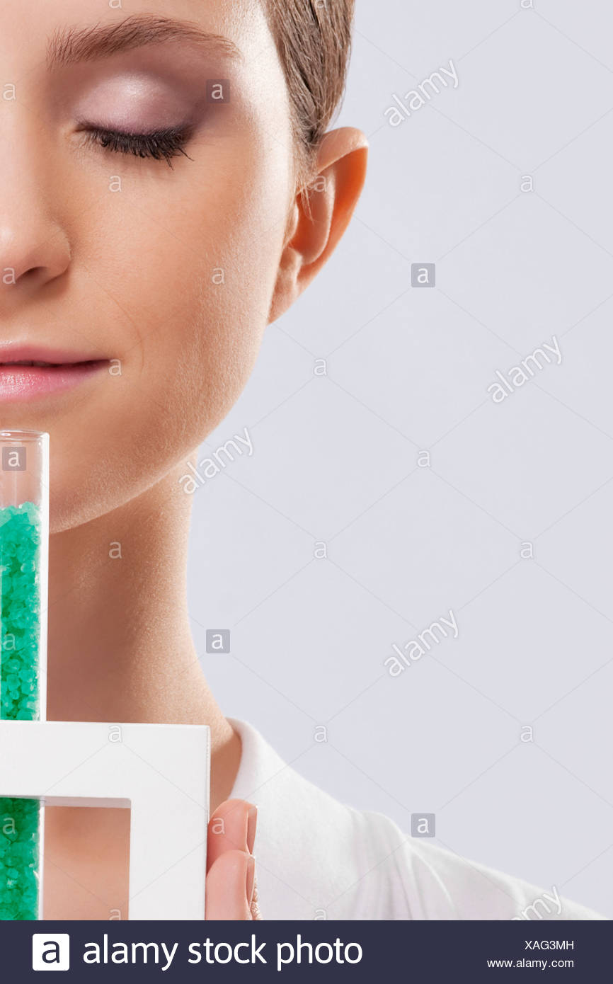 Woman smelling bath crystals - Stock Image