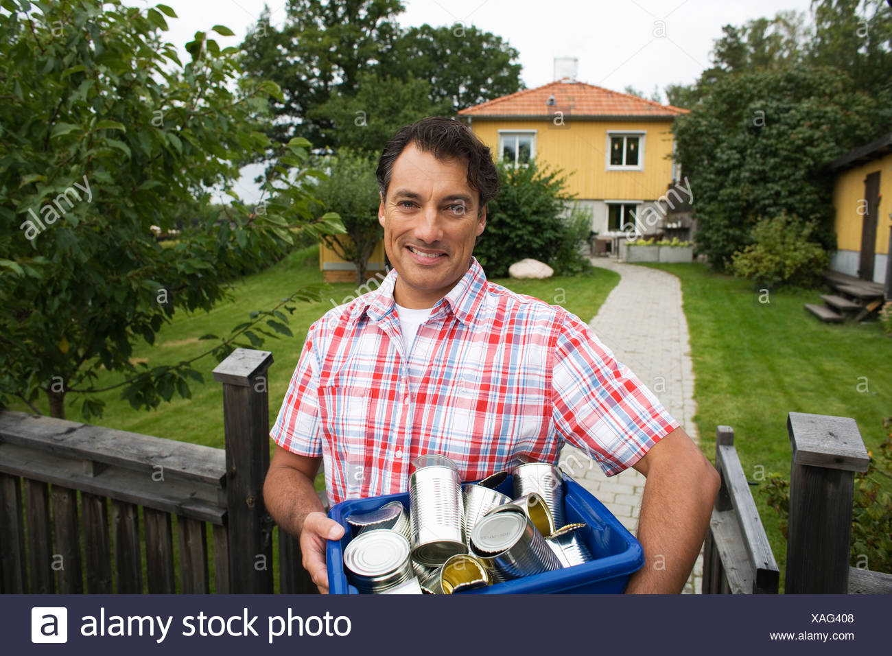 A man recycling aluminium cans Sweden. - Stock Image
