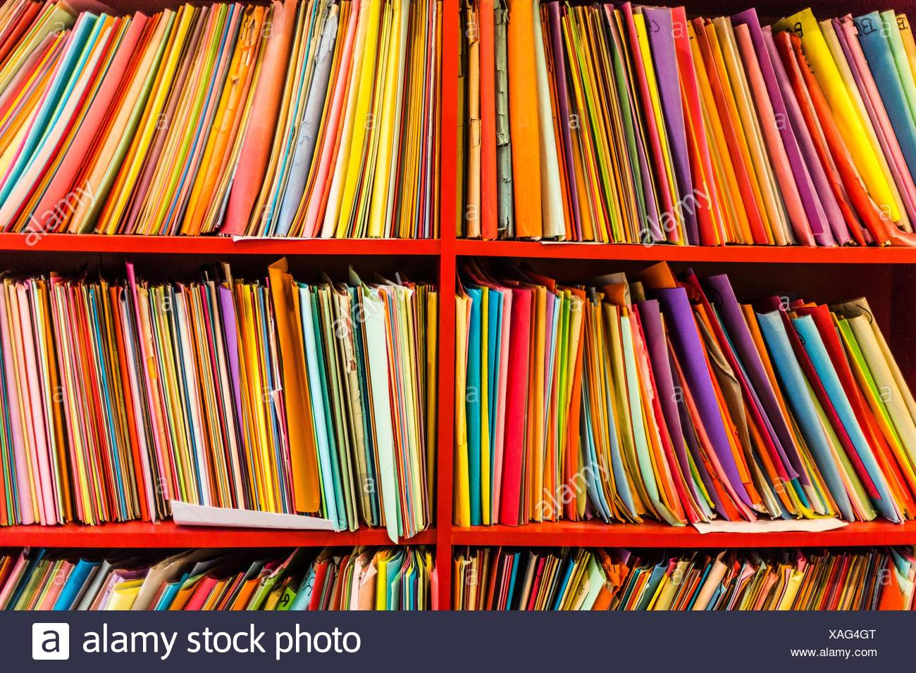 Records on shelves. - Stock Image