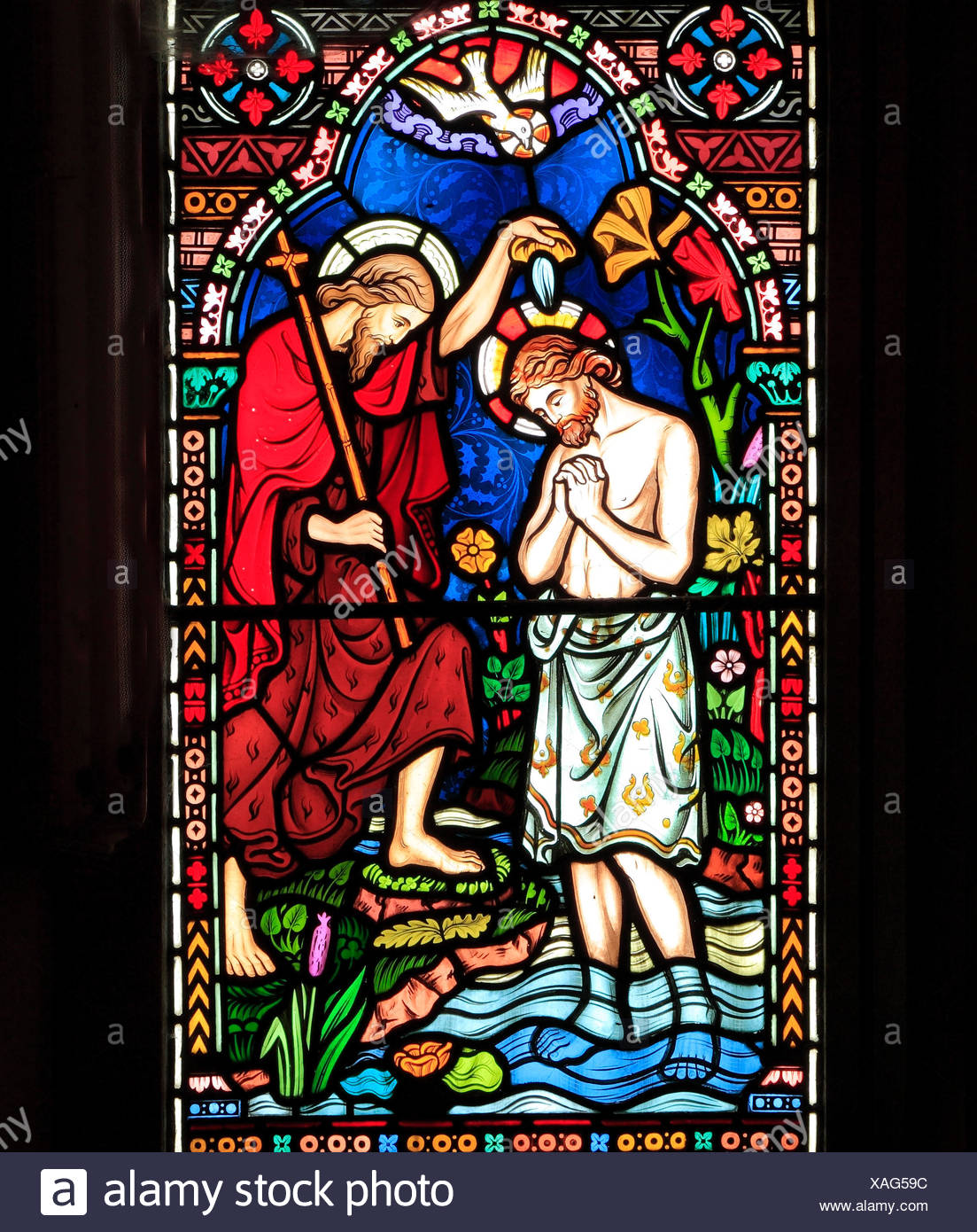 Life of Jesus, Baptism by John the Baptist, in River Jordan, stained glass window by Frederick Preedy, 1865, Gunthorpe, Norfolk, England, UK - Stock Image