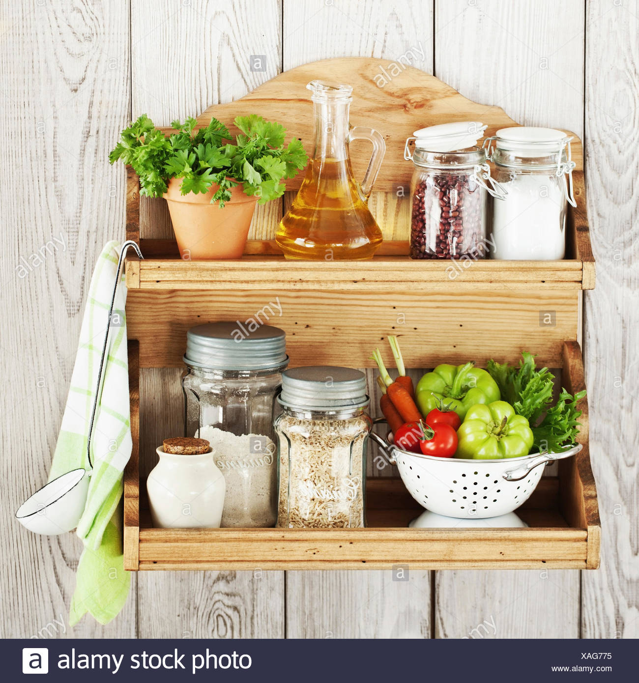 Kitchenware and products on a shelf - Stock Image