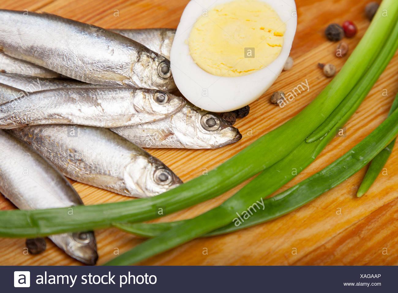 food aliment salt pepper wood shell silver freshness small tiny little short spring bouncing bounces hop skipping frisks - Stock Image