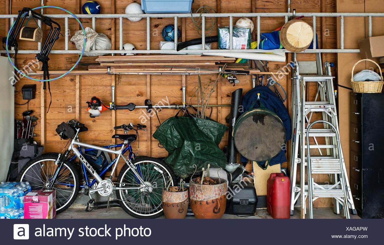 Cluttered interior garage storage. - Stock Image