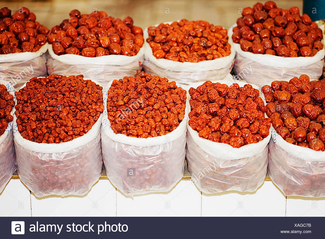 Sacks of dried berries at a market stall, Tai'an, Shandong Province, China - Stock Image
