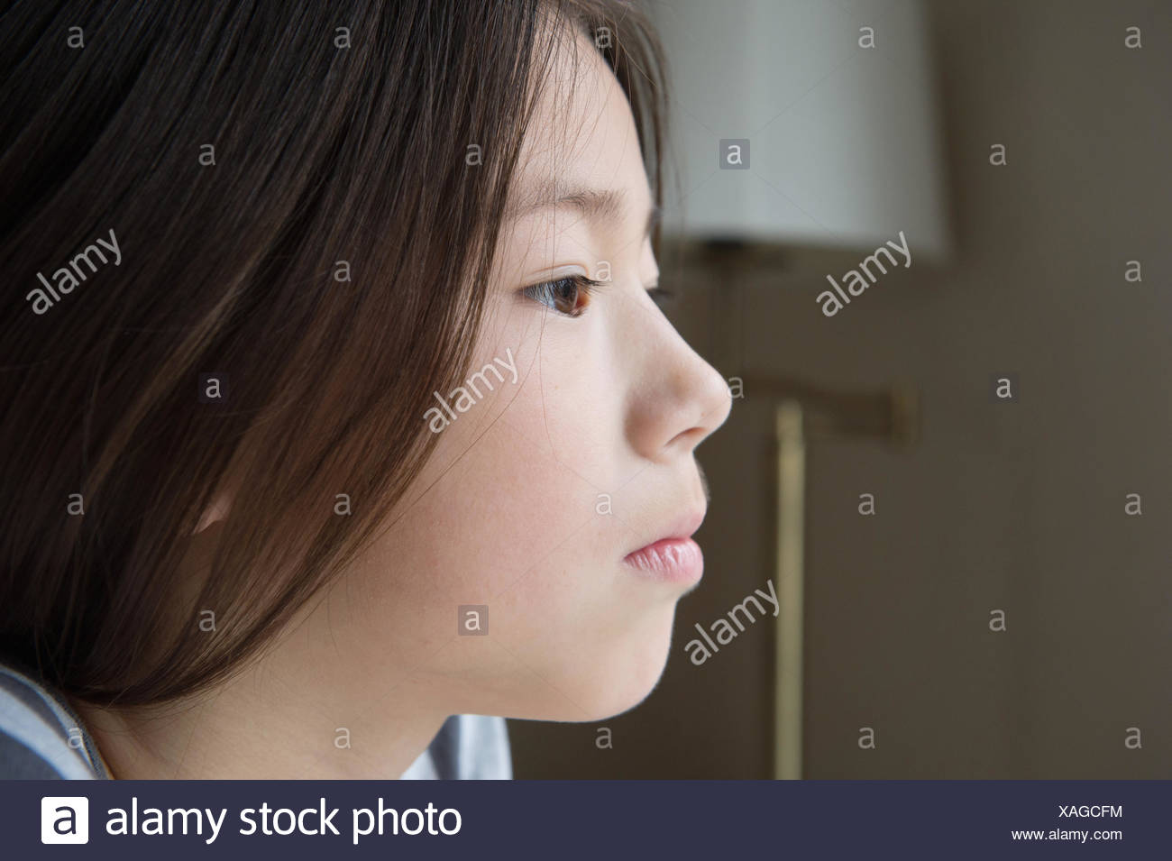 Close up portrait of serious girl - Stock Image