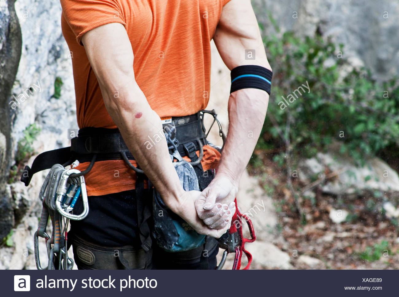 Italy, Mid section of climber - Stock Image