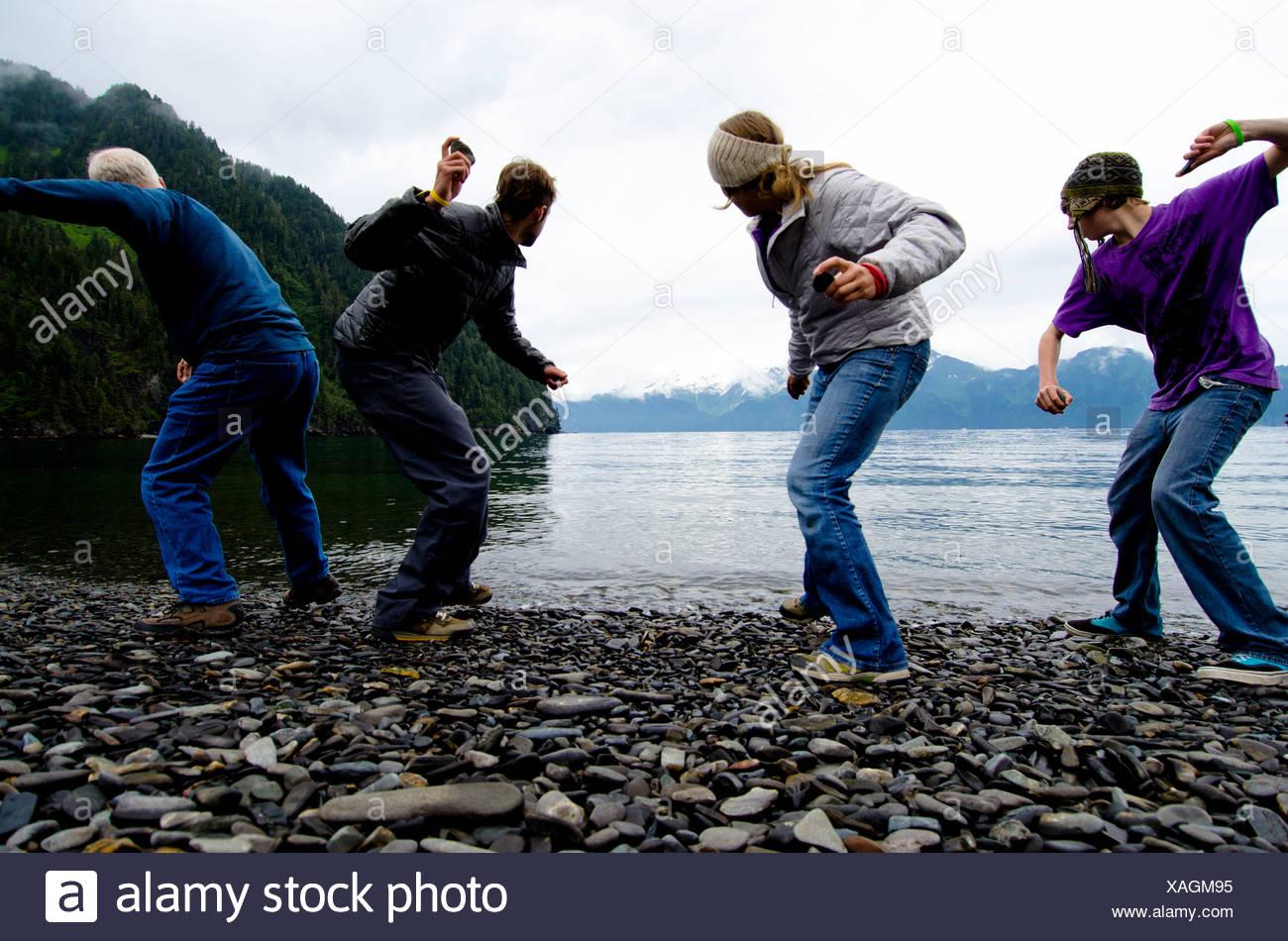 Ready, set, rock-skipping contest on Fox Island, Alaska. - Stock Image