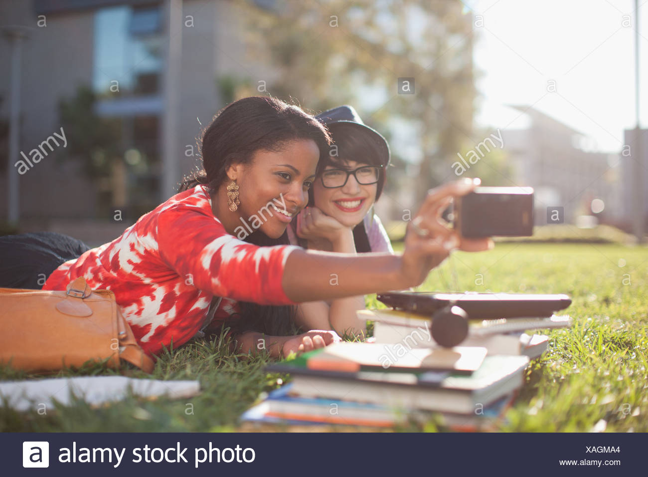 Two girls photographing themselves - Stock Image