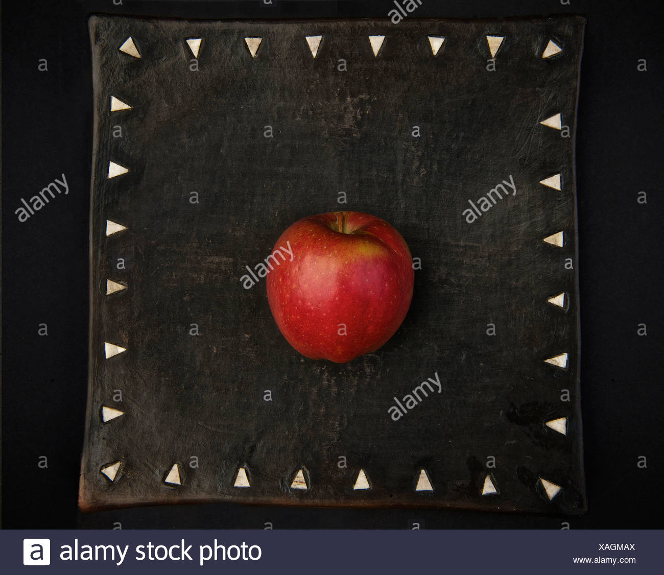 Apple on decorative board - Stock Image
