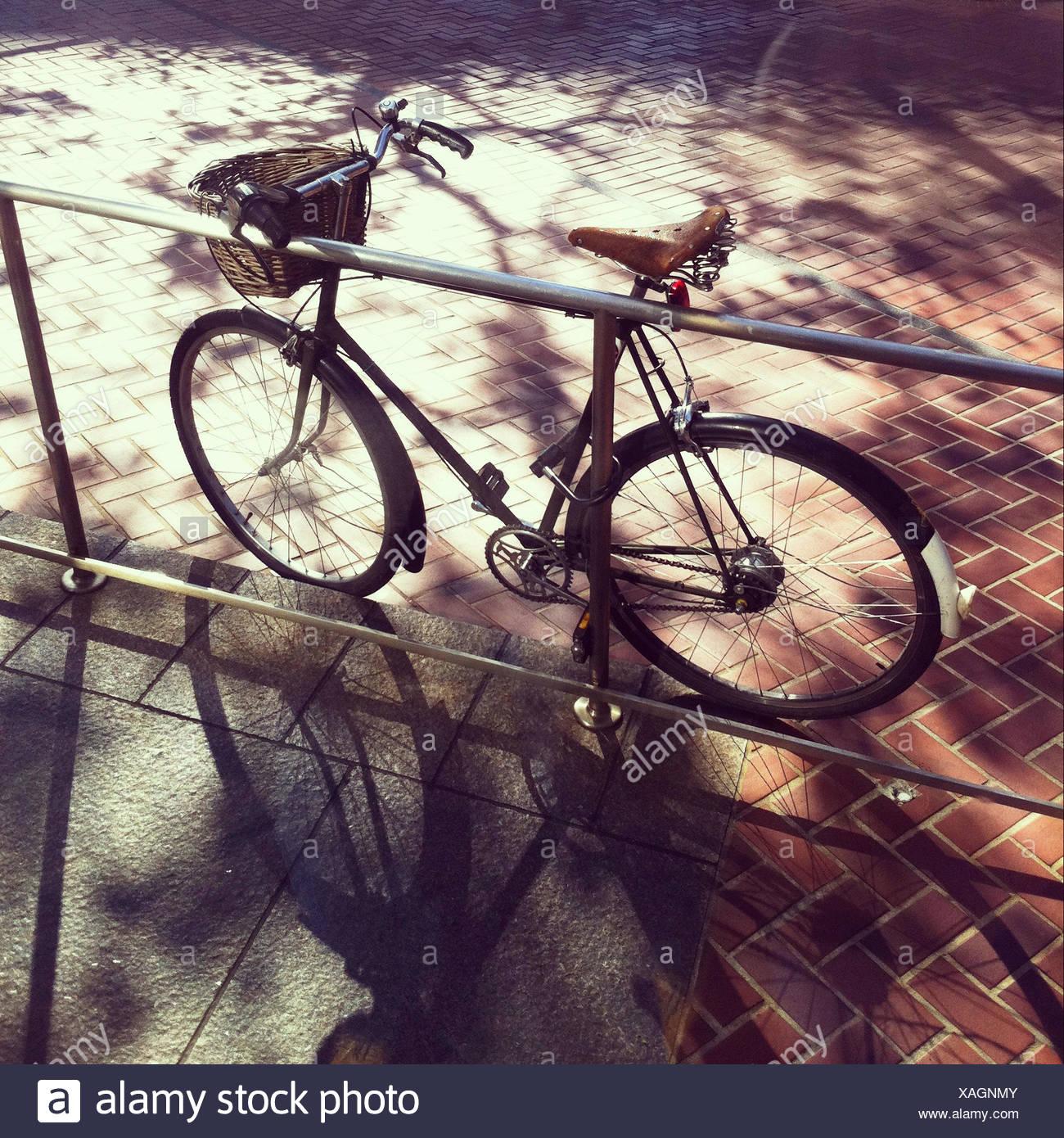 Bicycle locked to railing - Stock Image