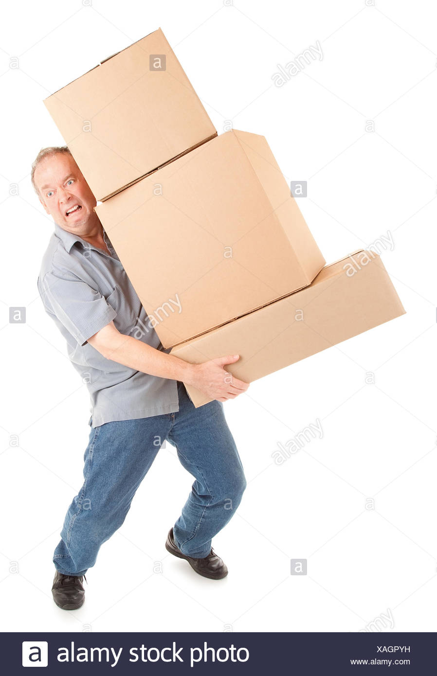 A man is painfully carrying boxes. Stock Photo