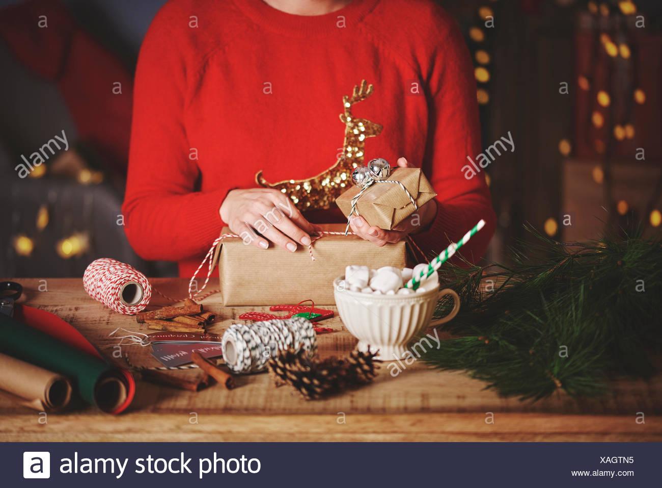 Woman wrapping christmas gifts Stock Photo: 281883089 - Alamy