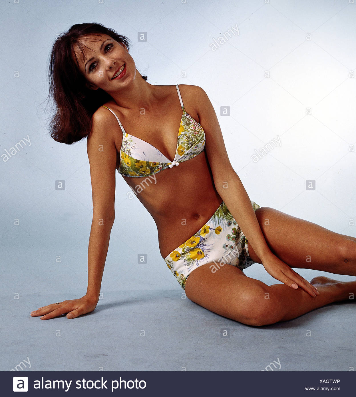fashion, 1960s, model, wearing bikini, half length, sitting, studio, flower, flowers, , Additional-Rights-Clearances-NA - Stock Image