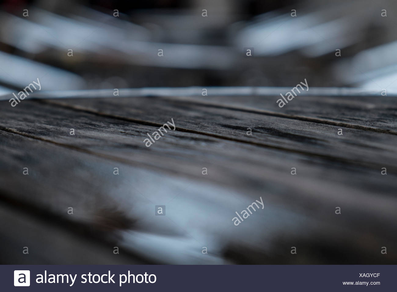 Wooden table with low depth of field - Stock Image