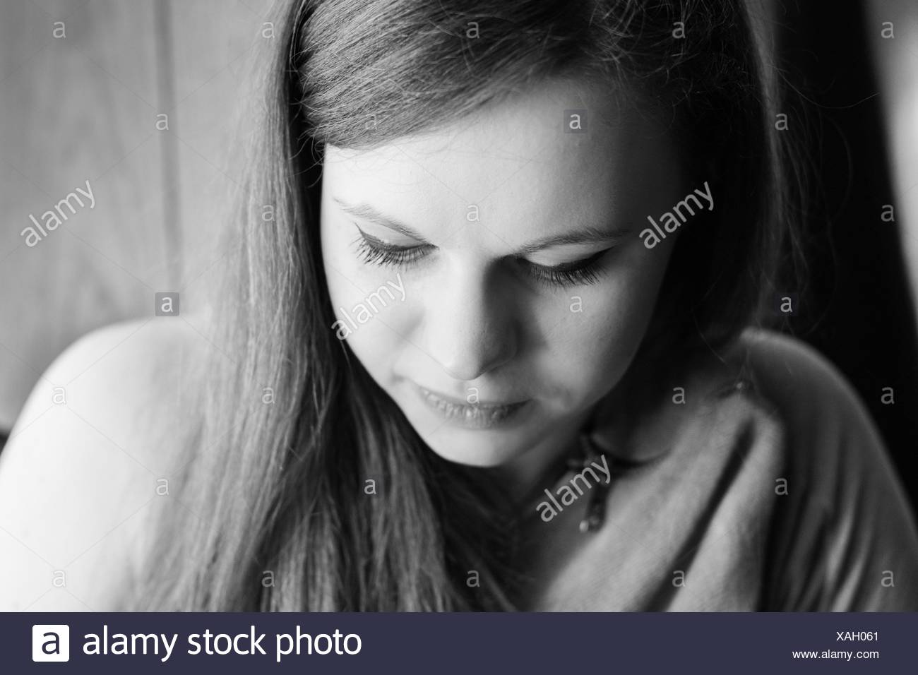 Close-Up Of Young Woman Looking Down Stock Photo