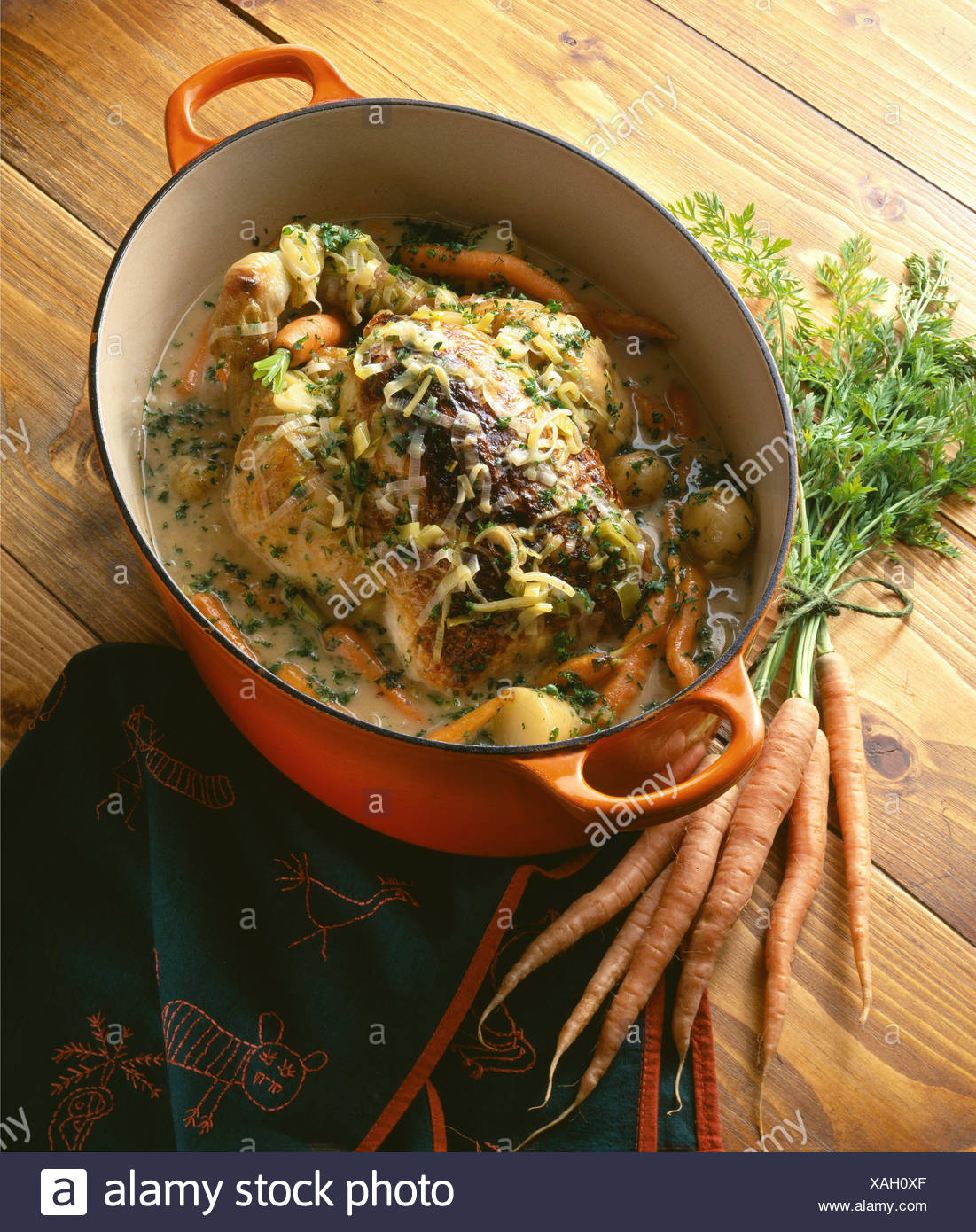 Farmhouse Chicken in a pot Fresh tangy, the heady aromas of herbs, cider, and springtime vegetables, this chicken casserole - Stock Image