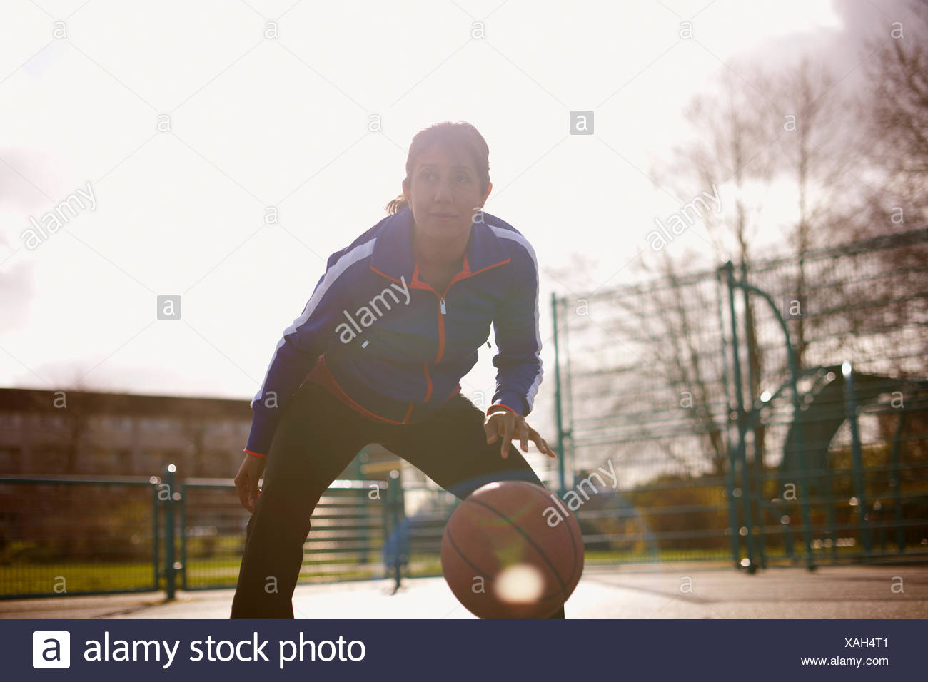 A Woman Playing Basketball Imágenes De Stock A Woman: Adult Female Basketball Player Asian Stock Photos & Adult