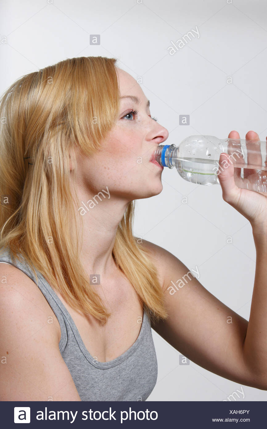 Young woman drinking from water bottle, portrait Stock Photo