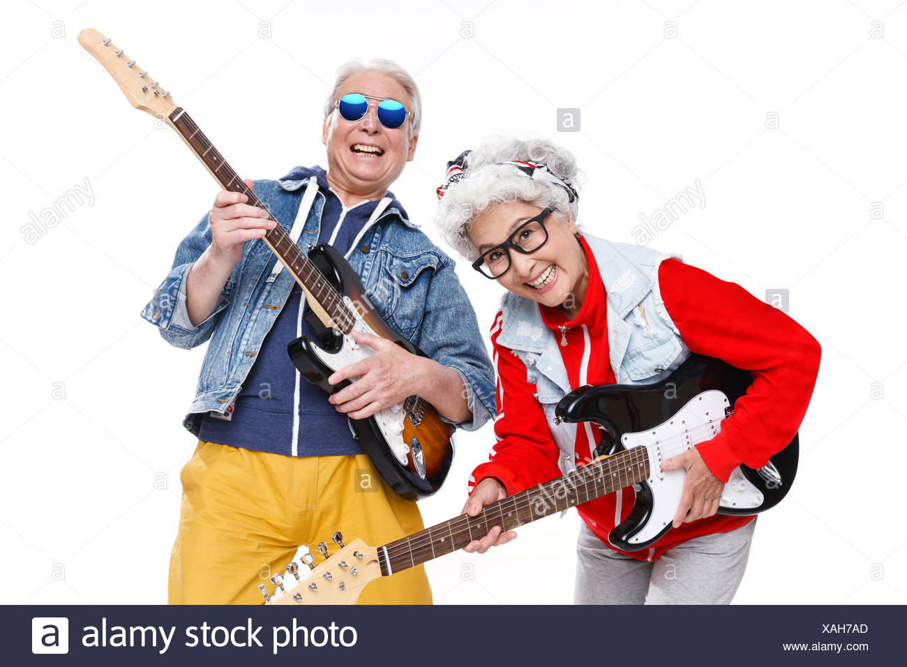 Two fashion of elderly people playing the guitar - Stock Image