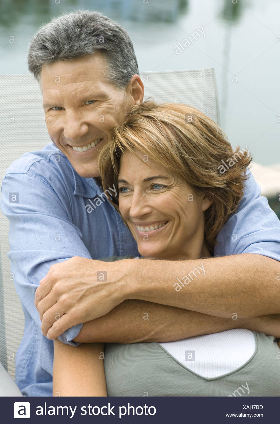 Mature couple, man with arms around woman - Stock Image