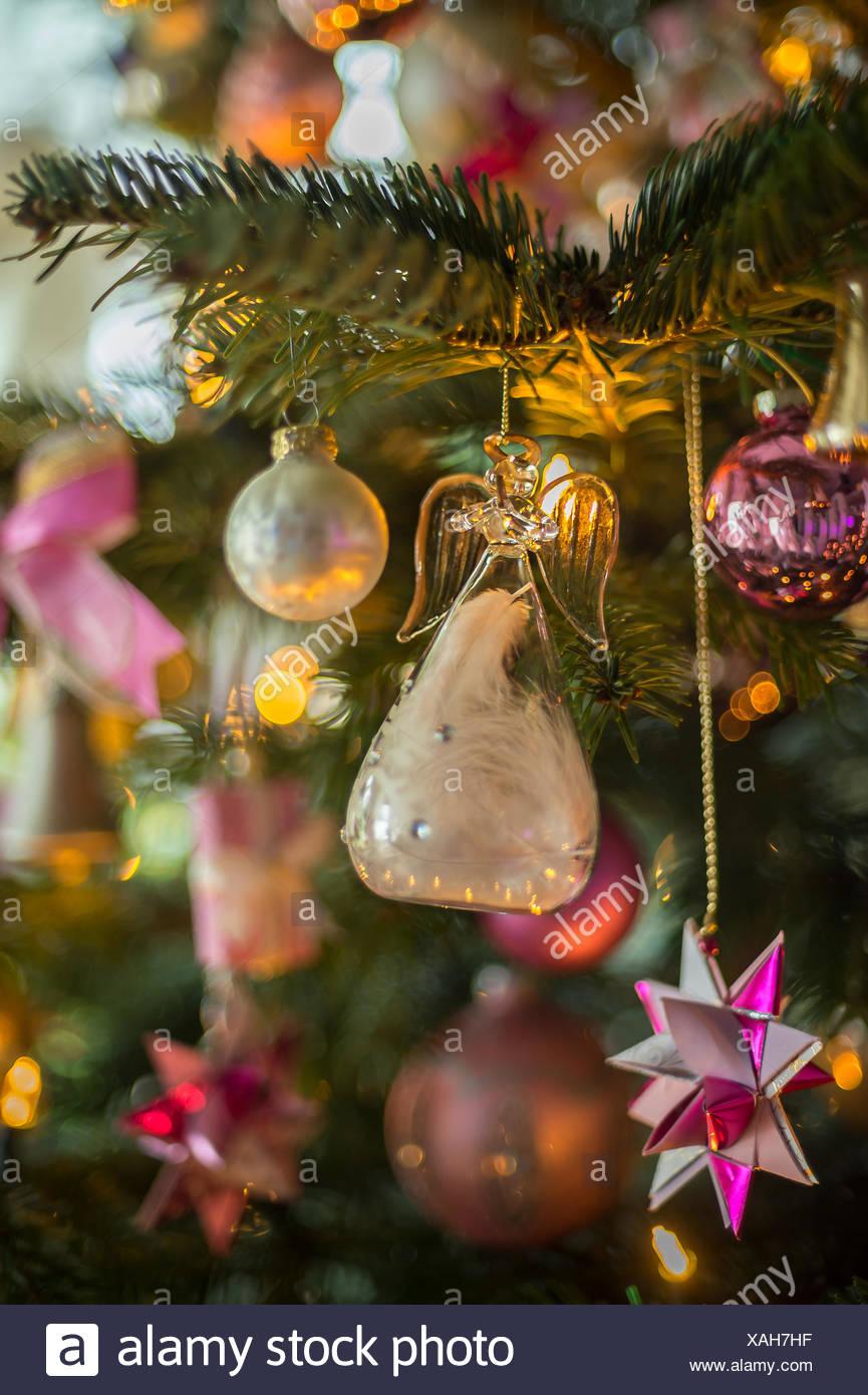 christmas angel made of glass on tannenbaum - Stock Image